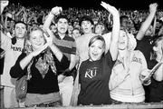 Kansas University students celebrate at Traditions Night on Aug. 15 at Memorial Stadium. Traditions Night is part of KU's annual Hawk Week, which introduces students to the university.