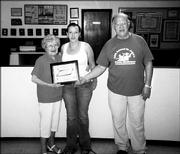 Nichole Kennedy, center, receives the third annual James Hill Memorial Scholarship in this August file photo. She is pictured with Bridgie Hill, widow of James Hill, and John Callewaert, grand knight of the Knights of Columbus Council 1372.