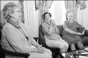 West Side Study Club members, from left, Dorothy Fritzel, Margaret Freeman and Elsie Hemphill, talk about the club that started in 1901 in Lawrence. Today, nine women meet monthly from September to May.