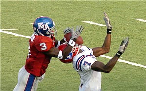 KU's Charles Gordon (3) breaks up an intended pass in the first half against Louisiana Tech's Johnathan Holland (7), in September, 2005.
