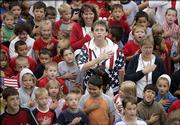 Bremen Elementary/Middle School students and teachers recite the Pledge of Allegiance during Constitution Day ceremonies Friday near the flag pole in front of the school in Bremen, Ind.