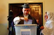 Afghan President Hamid Karzai votes in the parliamentary election in Kabul. Afghans are voting for parliamentary candidates today in another crucial step toward democracy.