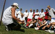 Coach Lori Navarro talks with the Liberal High School varsity soccer team during a practice in Liberal. Everyone on the team - players, coaches, trainers and managers - are Hispanic, and both English and Spanish are spoken.