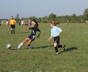 Force forward Alexa Harmon-Thomas kicks the ball in front of her as she drives down field against the KC Lightning on Saturday during the first round of pool play in the Kansas Cup All-Girls tournament At Youth Sports Inc. The Lightning and the Kaw Valley Force 10U girls tied, 3-3 which was good for 3 points per team in the tournament standings.