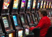 Ruth Ann Croshaw, of Wahoo Neb., plays a two-cent slot machine at the Golden Eagle Casino, 6 miles west of Horton.