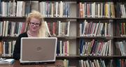 Andrea Hoag, a freelance writer from Oskaloosa, composes a book review on her laptop at the Lawrence Public Library.
