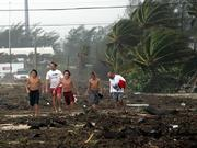 A group of boys walk down the middle of a debris and sand strewn section of U.S. Highway1 as Hurricane Rita passes through Tuesday in Islamorada, Fla. Hurricane Rita raked the Florida Keys on Tuesday with high winds and torrential rains as it pushed into the warm waters of the Gulf of Mexico, where forecasters said the storm is likely to grow into a major hurricane that could eventually strike Texas or Louisiana.