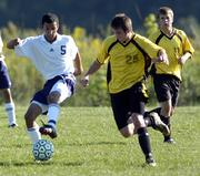 Seabury Academy's Max Cannon, left, moves the ball against an Atchison Maur Hill Prep defender during Tuesday's game at the Youth Sports Inc. fields. Seabury won, 2-1.