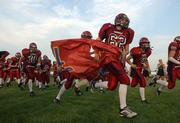 Eudora High football players take the field against Wellsville prior to the season opener for both teams. EHS won, 12-6, Sept. 2 in Eudora, the first of three straight victories to open the season.