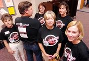Southwest Junior High teachers, from left, Maureen Williams, Jim Frink, Danielle Lotton-Barker, Jane Liggett, Christine Drinkhouse and Renee Harders don special T-shirts to the latest round of teacher negotiations.