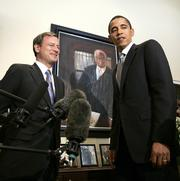 Supreme Court Chief Justice nominee John Roberts, left, and Sen. Barack Obama, D-Ill., stand in front of a portrait of Thurgood Marshall, civil rights lawyer and the first African American Supreme Court Justice, in Obama's office on Capitol Hill.