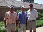 From left, Curt Wright, Kent Houk and Matt Lomchek participate in the Cottonwood Classic, a benefit for Cottonwood Inc. The team, from MGI Inc., along with Leon Dreiling, not pictured, took first place in the championship flight Aug. 19 at Alvamar Country Club.