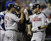 Cleveland's Travis Hafner, right, and Jhonny Peralta celebrate Hafner's two-run home run in the third inning. The Indians won, 7-6, Friday in Kansas City, Mo.