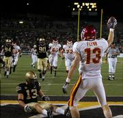Iowa State's Austin Flynn holds up the ball while Army's Caleb Campbell, left, sits in the end zone. The Cyclones beat the Cadets, 28-21, Friday in West Point, N.Y.