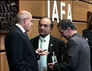 International Atomic Energy Agency head Mohamed ElBaradei, left, talks with a member of the board of governors representing South Africa, Abdul Samad Minty, center, and Iran's permanent representative to the UN in Vienna, Mohammad Mehdi Akhondzadeh, before an IAEA board of governors meeting Friday in Vienna, Austria.