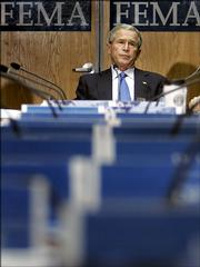 President Bush attends a briefing on Hurricane Rita on Friday at FEMA headquarters in Washington. Federal response to Hurricane Katrina has had the Bush administration slipping in approval ratings.