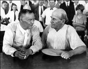 Clarence Darrow, left, and William Jennings Bryan sit beside each other at the Scopes Monkey Trial in Dayton, Tenn., in this 1925 file photo. Darrow was one of three lawyers sent to Dayton by the American Civil Liberties Union to defend John T. Scopes, a biology teacher, in his test of Tennessee's law banning the teaching of evolution. Bryan testified for the prosecution as a Bible expert.