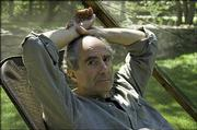 Novelist Philip Roth, 72, sits inside a screened tent at his home in Warren, Conn. Roth's complete works will be published by the Library of America, with the first two volumes out this fall.