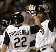 Chicago White Sox outfielder Jermaine Dye, right, celebrates his home run against Minnesota with teammates Scott Podsednik and Paul Konerko, partially obscured. The White Sox beat the Twins, 3-1, Friday in Chicago.