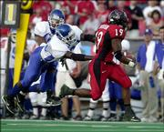Texas Tech running back Taurean Henderson (19) runs away from Indiana State's Darryl Morton, left, and Matt Ludwig. The Red Raiders rolled to a 63-7 victory Saturday in Lubbock, Texas.