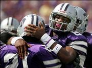 Kansas State quarterback Allen Webb (8) celebrates a first-half touchdown with running back Carlos Alsup. K-State routed North Texas State, 54-7, Saturday in Manhattan.