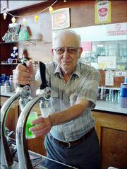 Richard Huckriede serves a soda Monday at the Hunter Drug Store in Greensburg. Huckriede was 23 when he first started working behind the counter of the drug store as a soda jerk and at 76 he still serves soda.