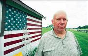 Jim Wren stands outside his wood working shop June 2 next to U.S. Highway 40 in South Vienna, Ohio. Wren, 66, has lived near the National Road all his life. Ohio is stepping up its promotion of the National Road, the nation's first federally funded interstate highway.