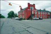 The Red Brick Tavern, shown June 2 in Lafayette, Ohio, has operated as a restaurant and tavern on U.S. Highway 40 since it was built in 1837. Ohio is stepping up its promotion of the National Road, the nation's first federally funded interstate highway.