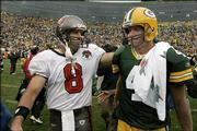 Tampa Bay quarterback Brian Griese, left, meets Green Bay QB Brett Favre after their game. The Buccaneers beat the Packers, 17-16, Sunday in Green Bay, Wis., dropping the Pack to 0-3.