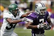 Kansas State running back Parrish Fsher, right, is forced out of bounds by North Texas defender Ja'Mel Branch. Fisher and the Wildcats routed the Mean Green, 54-7, Saturday in Manhattan, showing they could contend this season for the Big 12 North title.