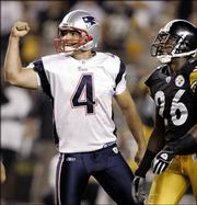 New England kicker Adam Vinatieri (4) celebrates his game-winning field goal as Pittsburgh's Deshea Townsend watches it sail through the uprights. The Patriots beat the Steelers, 23-20, on Vinatieri's last-second boot Sunday in Pittsburgh.