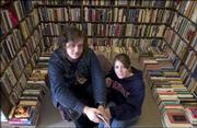 Nate Barbarick, a Kansas University senior from Olathe, and Natalie McAllister, a junior from Topeka, are working to start a campus literary journal primarily for writers. They are pictured Friday afternoon at The Dusty Bookshelf, 708 Mass.