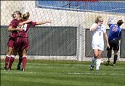 Two Texas A&M players celebrate a first-half goal in front of Kansas University midfielder Jenny Murtaugh (2) and goalkeeper Colleen Quinn. The Aggies beat the Jayhawks, 3-2, Sunday afternoon at the Jayhawk Soccer Complex.