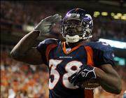 Denver running back Mike Anderson salutes the fans after his first-quarter TD.