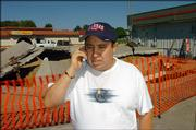 Angel Alvarez, shown on the phone in business discussions, plans to relocate his restaurant, Tortas Jalisco, following an accident at its former location, the Miller Mart, 3300 W. Sixth St.