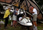 From left, Diane Sanders, Lawrence, Mike Lewis, Lee's Summit, Mo., and Alan Sanders, Lawrence, get a close-up view of the Papalotzin team's ultralight plane on display outside of Kansas University's Foley Hall on Monday.