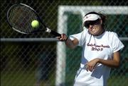Lawrence High's Laura Wilson returns the ball against Free State. FSHS won the city tennis dual, 6-3, Monday at Free State.