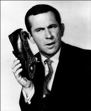 Don Adams is seen in character as Maxwell Smart.
