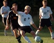 Free State High senior Aaron Ideus (6) moves the ball upfield against Topeka High. Ideus, a senior, and the Firebirds will play Olathe East tonight in the state tournament.