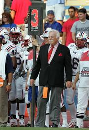 Florida Atlantic coach Howard Schnellenberger looks for a first down during the first half of the Owls' 30-19 loss to Kansas University. FAU, which lost its season opener Sept. 3 in Lawrence, will travel Saturday to Louisville, where Schnellenberger helped build the Cardinals into a winning program with national-title aspirations.