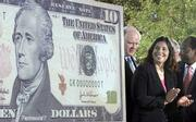 John Snow, left, secretary of the Treasury; Anna Escobedo Cabral, center, treasurer of the United States, and Roger Ferguson Jr., vice chairman for the Board of Governors of the Federal Reserve System, attend a ceremony Wednesday that unveiled the new $10 note.
