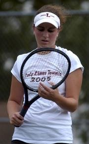 Lawrence High No. 1 singles player Emily Thompson stares at her racket after hitting a groundstroke into the net. Thompson lost the match to Blue Valley West's Rebekah Lynn on Wednesday at the Lawrence Tennis Center.