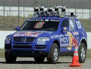 A modified Volkswagen Toureg, built by students and faculty from Stanford University, navigates around a cone on a course at the California Speedway in Fontana, Calif. The robot was among the top finishers during the Defense Advanced Research Projects Agency Grand Challenge on Wednesday.