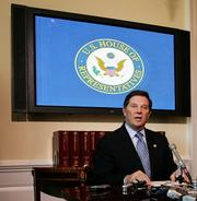 House Majority Leader Tom DeLay, R-Texas, makes a statement in his office on Capitol Hill. A Texas grand jury on Wednesday charged DeLay and two political associates with conspiracy in a campaign finance scheme, forcing the House majority leader to temporarily relinquish his post.