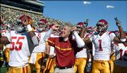 Southern California head coach Pete Carroll cheers with his team in front of their supporters prior to the start of USC's 25th straight victory, a 45-13 win Saturday over Oregon. USC heads Saturday to Sun Devil Stadium, where college football's two most recent notable winning streaks have come to an end.