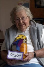 Katharine Kelley displays her Best of Show peaches in this photo from the 2004 Vinland Fair. Kelley, 96, died Tuesday. She taught elementary school for decades and also worked at the Baldwin City Library after she retired.