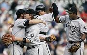 From left, Chicago's Paul Konerko, Joe Crede, A.J. Pierzynski and Juan Uribe celebrate after winning the AL Central. The White Sox defeated the Tigers, 4-2, Thursday in Detroit.