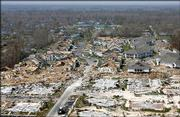 Empty foundations and destroyed homes litter the Gulf Coast on Sept. 13 in Gulfport, Miss., in the wake of Hurricane Katrina. Victims who lost their homes face a difficult task rebuilding amid a shortage of manpower and materials.