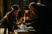 "Oliver (barney Clark), left, is schooled by Fagin (Ben Kingsley) while the Artful Dodger (Harry Eden) looks on in Roman Polanski&squot;s new adaptation of Charles Dickens&squot; ""Oliver Twist."""