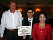 From left, Bo Harris, Dan Sabatini and Betty Morris celebrate receiving the Lawrence Board of Realtors&#39; annual Architectural Enhancement Award for the Hobbs Taylor Lofts project in downtown Lawrence. Harris is chief executive officer and chairman of Harris Construction Co. Inc., which is developing the building at the northeast corner of Eighth and New Hampshire streets. Sabatini, of Sabatini Architects Inc., is project designer; and Morris, a Realtor for Stephens Real Estate, is marketing the project. They were honored during a ceremony Sept. 20 at Lawrence Country Club.
